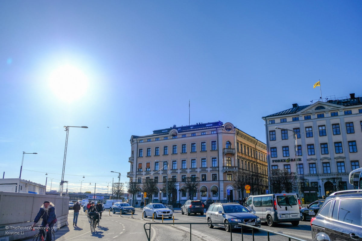 cyclists and road traffic near Slussen   Stockholm in 48 Hours • The Petite Wanderess